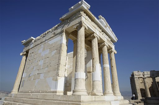 The elegant marble temple of Athena Nike, fronted by four slender Ionic columns, stands free of scaffolding on the Athens Acropolis, Tuesday, Sept. 7, 2010. A ten-year restoration project has just been completed on the 2,400-year-old temple, which was dismantled to ground level and rebuilt to correct damage from ground subsidence and rusting internal joints. (AP Photo/Petros Giannakouris)