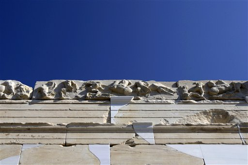 A copy of the original sculptured frieze is seen on the elegant marble temple of Athena Nike on the Athens Acropolis, Tuesday, Sept. 7, 2010. A ten-year restoration project has just been completed on the 2,400-year-old temple, which was dismantled to ground level and rebuilt to correct damage from ground subsidence and rusting internal joints. (AP Photo/Petros Giannakouris)