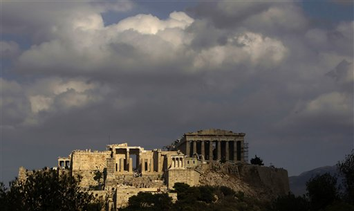 In this photo taken Sunday, Sept. 5, 2010, the elegant marble temple of Athena Nike, distinguished by its four Ionic columns, is lit by the sun as the Propylaea gate is seen on the left and the Parthenon temple in the shade on the right, on the Athens Acropolis. A ten-year restoration project has just been completed on the 2,400-year-old temple, which was dismantled to ground level and rebuilt to correct damage from ground subsidence and rusting internal joints. (AP Photo/Petros Giannakouris)