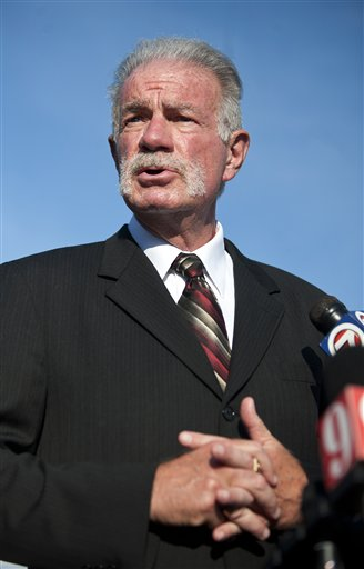 Pastor Terry Jones of the Dove World Outreach Center makes comments to reporters prior to a service at his church in Gainesville, Fla., Wednesday, Sept. 8, 2010. Jones stated that he is going forward with a scheduled burning of copies of the Quran at his church on Saturday, Sept. 11.(AP Photo/John Raoux)