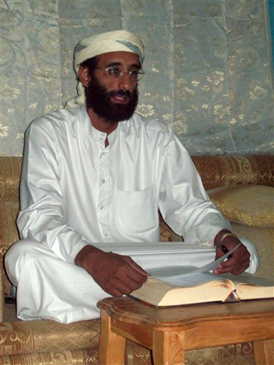 FILE - This October 2008 file photo by Muhammad ud-Deen shows Imam Anwar al-Awlaki in Yemen. The Obama administration is considering filing the first criminal charges against radical cleric Anwar al-Awlaki in case the CIA fails to kill him and he's is captured alive in Yemen. (AP Photo/Muhammad ud-Deen, File) MANDATORY CREDIT. NO SALES