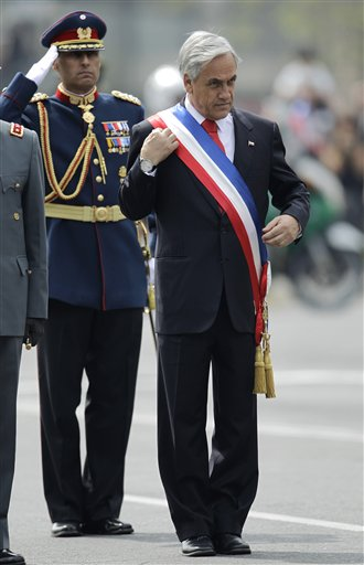 Chile's President Sebastian Pinera adjusts his presidential sash before receiving honors during Chile's Independence bicentennial celebrations in Santiago, Chile, Saturday, Sept. 18, 2010. (AP Photo/Roberto Candia)