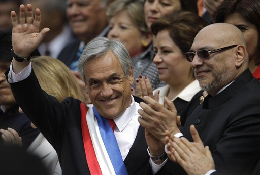 Chile's President Sebastian Pinera, left, waves accompanied by Paraguay's President Fernando Lugo after attending a Te Deum mass at the Metropolitan Cathedral as part of the celebrations of Chile's Independence bicentennial celebrations in Santiago, Chile, Saturday, Sept. 18, 2010. (AP Photo/Roberto Candia)