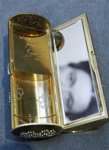 The interior, with an inscription 'Wallis from Edward 1947', of a Cartier gold and diamond necessaire du soir is seen on display at the auction house in London, Thursday, Sept. 23, 2010. The evening case, formerly in the collection of the Duchess of Windsor, was seen with the Duchess at a reception she and the Duke attended on the inviation of President Richard Nixon in 1970 is to be auctioned in 'The Jewels of the Duchess of Windsor' sale on Nov. 30 with an estimated price of 50,000 to 70,000 pounds (US$78,320 to 109,649 or 58,779 to 82,291 euro). (AP Photo/Sang Tan)