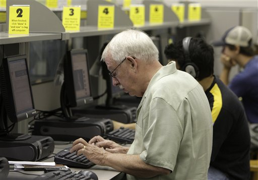 Dave Hetzler, of Grandview Heights, works on a computer at the Grandview Heights Public Library Wednesday, Sept. 1, 2010, in Grandview Heights, Ohio. Hetzler regularly uses the computers for checking email, travel reservations and research for his job. (AP Photo/Jay LaPrete)