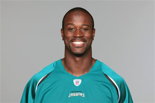 FILE - This is a 2010, file photo showing Jacksonville Jaguars football player Kassim Osgood. Osgood leapt out a second-floor window to escape a gun-wielding man who attacked him and a 19-year-old woman. According to the Jacksonville Sheriff's Office, the armed intruder exchanged gunfire with his ex-girlfriend, Mackenzie Rae Putnal, after putting a gun to her head on Monday night. (AP Photo/File)