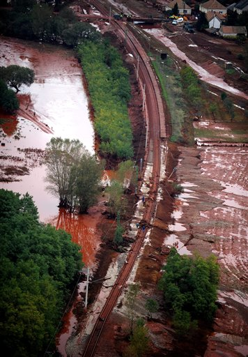 An aerial view of workers repairing a section of a railway line washed away by red mud in Devecser, 164 kms southwest of Budapest, Hungary, Wednesday, Oct. 6, 2010, after a dike of a reservoir containing red mud of a metals factory in nearby Ajka broke on Monday, and over one million cubic meters of the poisonous chemical sludge inundated three villages, killing an unknown number of persons and injuring over hundred. (AP Photo/MTI, Sandor H. Szabo)