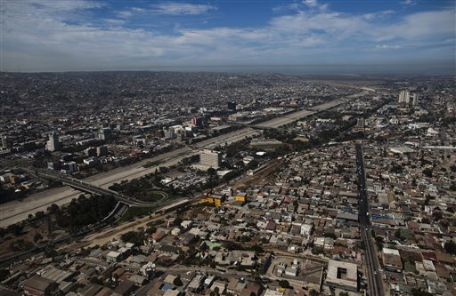In this Sept. 29, 2010 photo is seen an aerial view of Tijuana, Mexico. A two-week $5 million festival called Innovative Tijuana starts Thursday Oct. 7, 2010 in the border city across from San Diego and aims to showcase the city's economic prowess and cultural riches in an effort to demonstrate the city is no longer in the grip of warring drug traffickers. (AP Photo/Guillermo Arias)