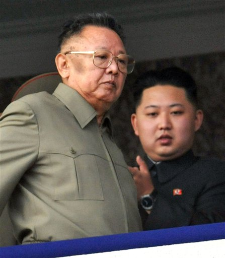 North Korea leader Kim Jong Il, left, walks by his son Kim Jong Un on the balcony as they attend a massive military parade marking the 65th anniversary of the communist nation's ruling Workers' Party in Pyongyang, North Korea on Sunday, Oct. 10, 2010. This year's celebration comes less than two weeks after Kim Jong Il's re-election to the party's top post and the news that his 20-something son would succeed his father and grandfather as leader. (AP Photo/Kyodo News) ** JAPAN OUT, MANDATORY CREDIT, FOR COMMERCIAL USE ONLY IN NORTH AMERICA **