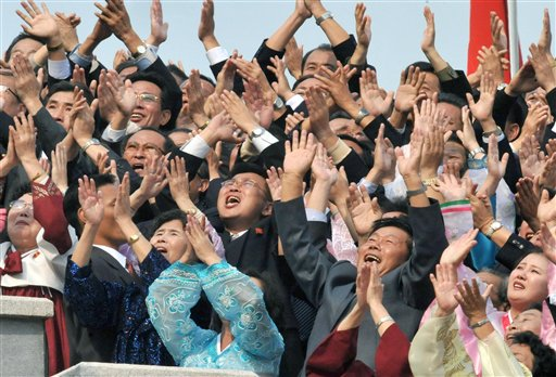 Participants clap and shout 'Long Live' at North Korea leader Kim Jong Il at the close of a massive military parade marking the 65th anniversary of the communist nation's ruling Workers' Party in Pyongyang, North Korea on Sunday, Oct. 10, 2010. This year's celebration comes less than two weeks after Kim Jong Il's re-election to the party's top post and the news that his 20-something son would succeed his father and grandfather as leader. (AP Photo/Kyodo News) ** JAPAN OUT, MANDATORY CREDIT, FOR COMMERCIAL USE ONLY IN NORTH AMERICA **
