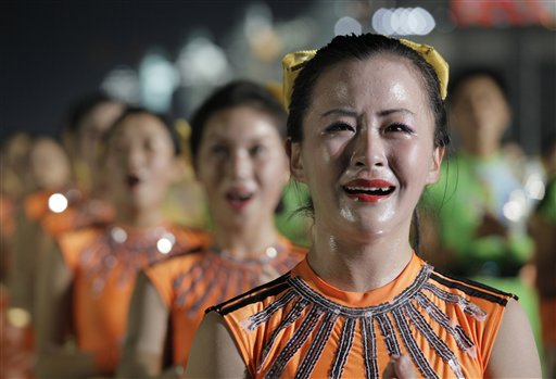 A North Korean dancer cries during a gala show to mark the 65th anniversary of the communist nation's ruling Workers' Party in Pyongyang, North Korea on Sunday, Oct. 10, 2010. This year's celebration comes less than two weeks after Kim Jong Il's re-election to the party's top post and the news that his 20-something son would succeed his father and grandfather as leader. (AP Photo/Vincent Yu)