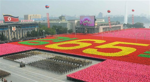 Human letters meaning '65' are created by participants on the Kim Il Sung Square as North Korea marked the 65th anniversary of the communist nation's ruling Workers' Party with a massive military parade in Pyongyang, North Korea on Sunday, Oct. 10, 2010. This year's celebration comes less than two weeks after Kim Jong Il's re-election to the party's top post and the news that his 20-something son would succeed his father and grandfather as leader. (AP Photo/Kyodo News) ** JAPAN OUT, MANDATORY CREDIT, FOR COMMERCIAL USE ONLY IN NORTH AMERICA **