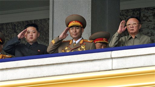 North Korea leader Kim Jong Il, right, and his son Kim Jong Un, left, salute from the balcony as they attend a massive military parade marking the 65th anniversary of the communist nation's ruling Workers' Party in Pyongyang, North Korea on Sunday, Oct. 10, 2010. This year's celebration comes less than two weeks after Kim Jong Il's re-election to the party's top post and the news that his 20-something son would succeed his father and grandfather as leader. (AP Photo/Kyodo News) ** JAPAN OUT, MANDATORY CREDIT, FOR COMMERCIAL USE ONLY IN NORTH AMERICA **