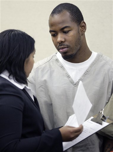 Dominic L. Holt-Reid, right, talks with his attorney Priya Tamilarasan during his arraignment hearing in Franklin County Common Pleas Court Wednesday, Oct. 20, 2010, in Columbus, Ohio. Reid accused of pointing a handgun at his pregnant girlfriend and forcing her to drive to an abortion clinic has been charged with attempted murder under an Ohio law prohibiting the unlawful termination of a pregnancy, a prosecutor said Wednesday. (AP Photo/Paul Vernon)