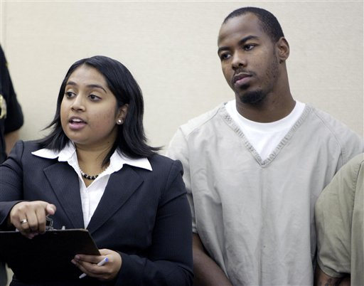 Dominic L. Holt-Reid, right, listens as his attorney Priya Tamilarasan talks to the judge during his arraignment hearing in Franklin County Common Pleas Court Wednesday, Oct. 20, 2010, in Columbus, Ohio. Reid accused of pointing a handgun at his pregnant girlfriend and forcing her to drive to an abortion clinic has been charged with attempted murder under an Ohio law prohibiting the unlawful termination of a pregnancy, a prosecutor said Wednesday. (AP Photo/Paul Vernon)