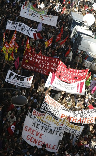 Students carry banners calling for a change in government policy on retirement, during a demonstration in Paris, Thursday Oct. 21, 2010. Protesters blockaded Marseille's airport, Lady Gaga canceled concerts in Paris and rioting youths attacked police in Lyon on ahead of a tense Senate vote on raising the retirement age to 62. A quarter of the nation's gas stations were out of fuel despite President Nicolas Sarkozy's orders to force open depots barricaded by striking workers. (AP Photo/Francois Mori)
