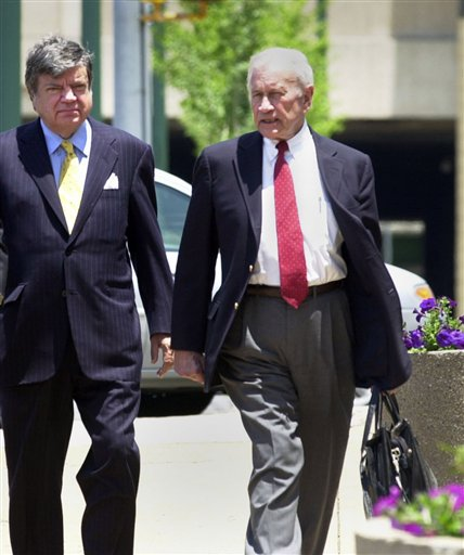 FILE - In a June 13, 2005 file photo, attorney James F. Neal, right, talks with his client, businessman Logan Young, center, as they enter into the Clifford Davis Federal building in Memphis, Tenn. Neal, who successfully prosecuted Jimmy Hoffa and Watergate figures and later defended high-profile clients, including Exxon Corp. after the Exxon Valdez oil spill, died Thursday, Oct. 21 in Nashville. He was 81. (AP Photo/Greg Campbell, File)