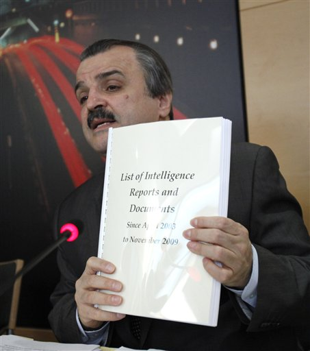 Chairman of the Foreign Affairs Committee of the National Council of Resistance of Iran, Mohammad Mohaddessin, holds up documents he claims relate to Iran's meddling in Iraq during a media conference in Brussels, Tuesday, Oct 26, 2010. Documents posted by WikiLeaks last week recount Iran's alleged role in arming and training Shiite militias in Iraq, where Tehran has also sought to influence politics. Iran denies these charges.(AP Photo/Virginia Mayo)