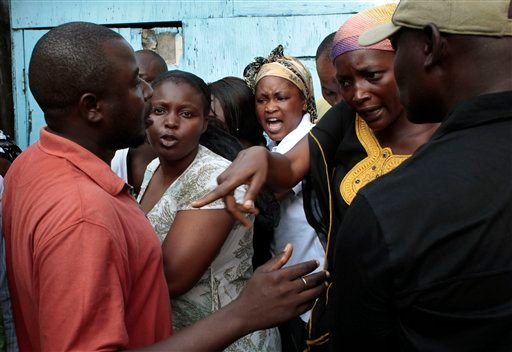 Voters argue as they wait in line to cast their ballot in the first round of presidential elections in Abidjan, Ivory Coast, Sunday Nov. 31, 2010. The West African nation of Ivory Coast held a long-awaited presidential election Sunday, the first since civil war erupted in 2002 and split the world's leading cocoa producer in half. Millions of people here are hoping the repeatedly delayed poll will reunite the divided country and restore stability after more than a decade of chaos and tension(AP Photo/Jerome Delay)