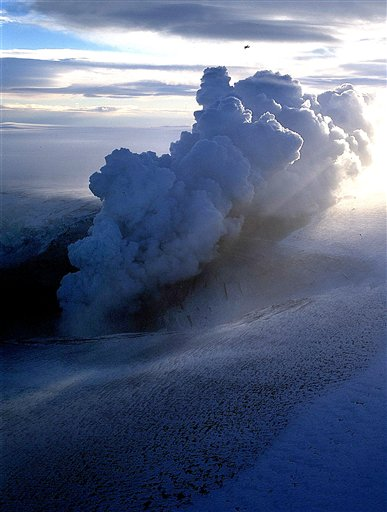 FILE - In this Thursday Nov. 4, 2004 file photo a cloud of ash erupts from Grimsvotn, a lake in the middle of Vatnajokull, the biggest glacier in Iceland. Torrents of water are pouring from a glacier that sits atop Iceland's most active volcano, an indication that the mountain is growing hotter and may be about to erupt, scientists said Monday, Nov. 1, 2010. The flood that began Thursday at the Grimsvotn volcano is similar to one in 2004 that lasted five days and ended with an eruption that disrupted European air traffic, University of Iceland geophysicist Pall Einarsson said. (AP Photo/ Pll Stefansson, File)