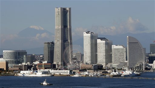Against a backdrop of a snow-capped Mount Fuji, Japan's highest mountain, skyscrapers soar at Yokohama port, south of Tokyo, Wednesday, Nov. 3, 2010. The Asia-Pacific Economic Cooperation summit will be held in Yokohama on Nov. 13 and 14. (AP Photo/Itsuo Inouye)
