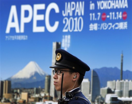 FILE - In this Nov. 2, 2010 file photo, a Japanese police officer stands guard near the APEC venue in Yokohama south of Tokyo for the Asia-Pacific Economic Cooperation forum leaders' summit to be held on Nov. 13 and 14. World leaders head to back-to-back economic summits in Asia next week, but regional political tensions _ some spawned by China's growing assertiveness _ could undermine attempts to project unity amid a faltering global economic recovery. (AP Photo/Itsuo Inouye, File)