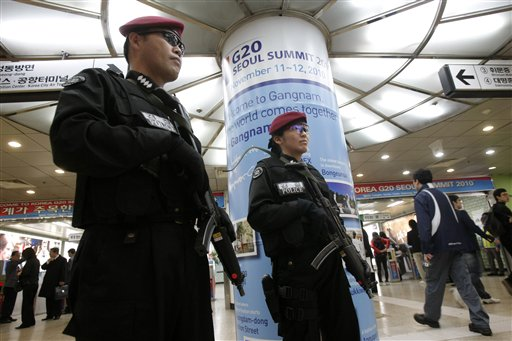 South Korean special police officers stand guard against possible terror attacks for the upcoming G-20 summit at a subway station in Seoul, South Korea, Thursday, Nov. 4, 2010. North Korea has been hacking into South Korean government computer networks with greater frequency to gather information on next week's meeting of world leaders in Seoul, a South Korean newspaper reported Thursday. (AP Photo/Ahn Young-joon)