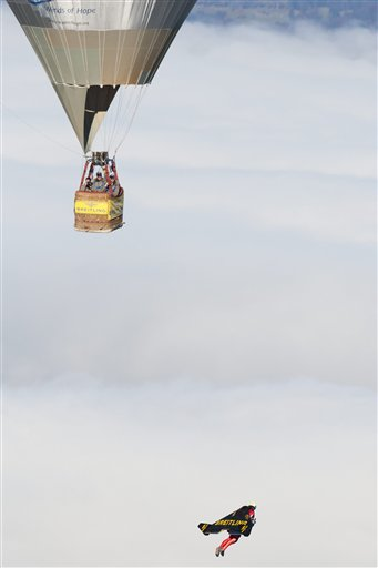 Swiss pilot Yves Rossy, the first man in the world to fly under a jet-fitted wing, speeds through the air to perform a looping in Bercher, western Switzerland, Friday, Nov 5, 2010. Rossy has completed two aerial loops using his custom-made jet-propelled wingsuit. Rossy jumped from a hot-air balloon above Lake Geneva and performed the daredevil stunt before landing safely with a parachute.(AP Photo/Keystone, Laurent Gillieron, pool)