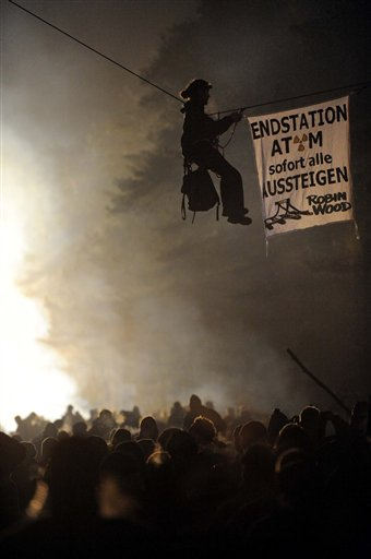 ** CORRECTS TO ADD DATE ** An activist of the environmental organization Robin Wood hangs from a rope that was fixed between two trees during a protest against the nuclear waste transport in Gorleben, northern Germany Tuesday Nov. 9, 2010. Trucks carrying 123 tons of nuclear waste have finally reached the storage facility in Gorleben after police worked through the night to clear thousands of protesters blockading the roads. Banner reads 'Final Stop, Atom, all get off immediately'. (AP Photo/dapd, Thomas Lohnes)