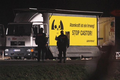 A truck of environmental organization Greenpeace blocks a road junction in Dannenberg, northern Germany, Monday, Nov. 8, 2010, prior to a road shipment of nuclear waste reaching them. The truck is adapted with flaps to prevent it from being moved. The shipment of nuclear waste from France eventually made it to a storage facility in northwestern Germany on Tuesday, after police worked through the night to clear a road blockade by more-than 3,000 protesters. (AP Photo/Michael Probst)