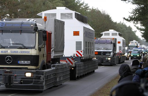 Flatbed trailer carrying Castors with nuclear waste arrive at the nuclear interim storage facility in Gorleben, Germany, Tuesday, Nov. 9, 2010. A shipment of nuclear waste from France made it to a storage facility in northwestern Germany on Tuesday, after police worked through the night to clear a road blockade by more-than 3,000 protesters. (AP Photo/Ferdinand Ostrop)