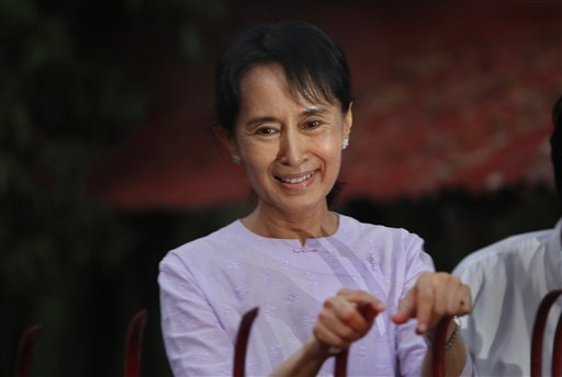 ** CORRECTS SPELLING OF MYANMAR ** Myanmar's pro-democracy leader Aung San Suu Kyi addresses her supporters from her house compound after her release from house arrest in Yangon, Myanmar, Saturday, Nov 13, 2010.(AP Photo)