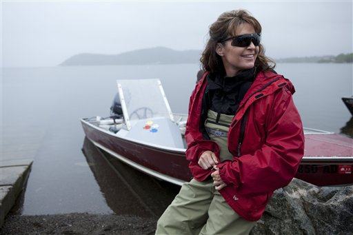 ** ADVANCE FOR SUNDAY, NOV. 14** In this photo taken July 2, 2010 and provided by the Discovery Communications, Sarah Palin waits by her husband Todd's boat before heading up river to see fish being counted in Dillingham, Alaska as part of a documentary for the TLC channel. 'Sarah Palin's Alaska' is fairly accurate with the facts about her home state. But more spot on is the title of the upcoming TLC documentary series. It's definitely Palin's Alaska, if not anyone else's. The first episode, airing Sunday, portrays the state with a sweeping grandeur not so readibly accessible for Alaskans with less time and money than the former Alaska governor and 2008 Republican vice presidential nominee. (AP Photo/Discovery Communications, Gilles Mingasson) NO SALES