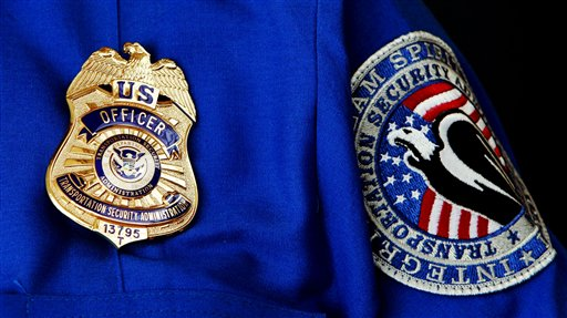 FILE - In this June 27, 2008 file photo, TSA Supervisor Jennifer Haslip poses with the new badge and uniforms at Washington's Ronald Reagan National Airport. The TSA has demonstrated a knack for ignoring the basics of customer relations, while struggling with what experts say is an all but impossible task. It must stand as the last line against unknown terror, yet somehow do so without treating everyone from frequent business travelers to the family heading home to visit grandma as a potential terrorist. (AP Photo/Pablo Martinez Monsivais, File)