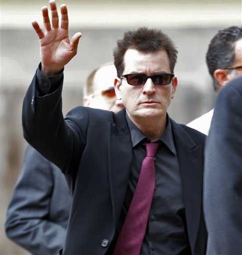 FILE - In a Aug. 2, 2010 file photo, Charlie Sheen waves as he arrives at the Pitkin County Courthouse in Aspen, Colo., for a hearing in his domestic abuse case. Appearing on ABC's 'Good Morning America' on Monday, Nov. 22, 2010, adult-film actress Capri Anderson, the woman found in Charlie Sheen's New York hotel room last month, says the actor hurled racial slurs, threw a lamp at her and grabbed her by the throat. She says she's suing Sheen for battery and false imprisonment, and plans to file a criminal report with New York police.(AP Photo/Ed Andrieski, File)