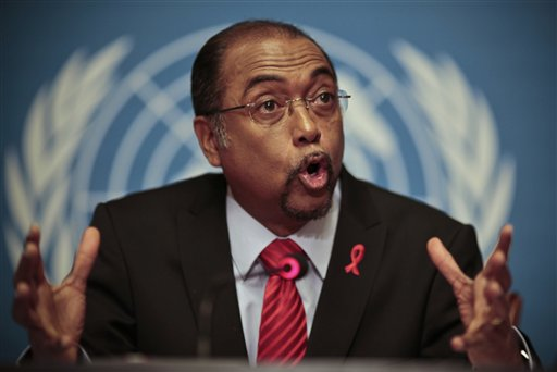 Michel Sidibe, Executive Director of UNAIDS, gestures during a press conference where he delivered the UNAIDS 2010 Global Report on the global AIDS epidemic at the United Nations in Geneva, Switzerland, Tuesday, Nov 23, 2010. In South Africa, the country with the world's largest HIV epidemic, the report suggests new infections have reduced by more than 25 percent. (AP Photo/Anja Niedringhaus)