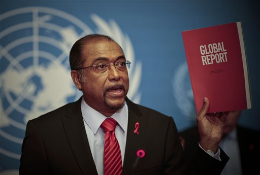 Michel Sidibe, Executive Director of UNAIDS, shows the UNAIDS 2010 Global Report on the global AIDS epidemic at the United Nations in Geneva, Switzerland, Tuesday, Nov 23, 2010. In South Africa, the country with the world's largest HIV epidemic, the report suggests new infections have reduced by more than 25 percent. (AP Photo/Anja Niedringhaus)