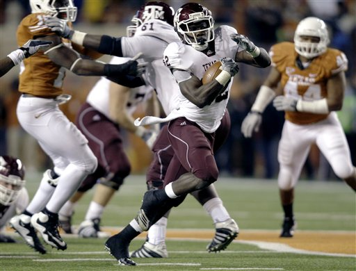 Texas A&M's Cyrus Gray, center, breaks away for a touchdown run against Texas during the third quarter of an NCAA college football game, Thursday, Nov. 25, 2010, in Austin, Texas. (AP Photo/Eric Gay)