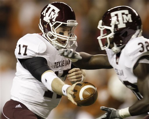 Texas A&M's Ryan Tannehill (17) hands off to Cyrus Gray (32) during the first quarter of an NCAA college football game against Texas, Thursday, Nov. 25, 2010, in Austin, Texas. (AP Photo/Eric Gay)