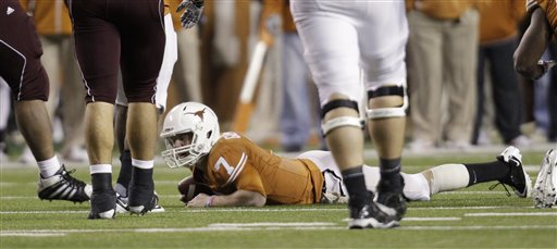 Texas' Garret Gilbert (7) lays on the turf after he was sacked by Texas A&M during the second quarter of an NCAA college football game, Thursday, Nov. 25, 2010, in Austin, Texas. (AP Photo/Eric Gay)