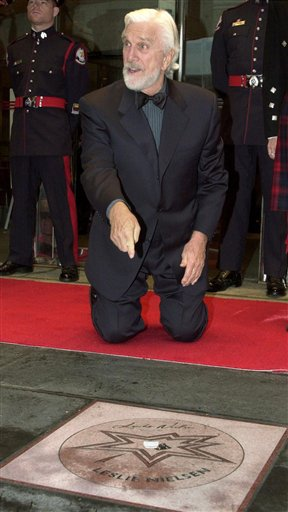 FILE - In this file photo taken June 1, 2001, actor Leslie Nielsen points to his star as he was inducted into the Walk of Fame along King Street in Toronto. Nielsen, known for his role in the 'Naked Gun'' comedies, has died, his agent John S. Kelly said Nielsen died Sunday, Nov. 28, 2010, at a hospital near his home in Ft. Lauderdale, Fla., where he was being treated for pneumonia. He was 84. (AP Photo/The Canadian Press, J.P.Moczulski, File)