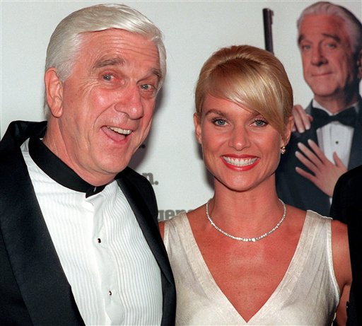 FILE - In this file photo taken May 16, 1996, actors Leslie Nielsen, left, and Nicollette Sheridan arrive at the El Capitan Theatre in Los Angeles for the premiere of 'Spy Hard.' The Canadian-born Nielsen, who went from drama to inspired bumbling as a hapless doctor in 'Airplane!' and the accident-prone detective Frank Drebin in 'The Naked Gun' comedies, has died. He was 84. His agent John S. Kelly said Nielsen died Sunday, Nov. 28, 2010, at a hospital near his home in Florida where he was being treated for pneumonia. (AP Photo/Michael Caulfield, File)