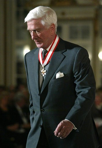 FILE - In this file photo taken Dec. 12, 2003, actor Leslie Nielsen walks off stage after receiving the Order of Canada from Governor General Adrienne Clarkson during a ceremony in Ottawa. The Canadian-born Nielsen, 84, has died in a Florida hospital on Sunday, Nov. 28, 2010, according to his agent John S. Kelly. (AP Photo/The Canadian Press, Jonathan Hayward, File)