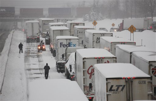 Truck driver John Joyce waits in a long line of stranded vehicles on the New York State Thruway during a winter storm in Buffalo, N.Y., Thursday, Dec. 2, 2010. (AP Photo/David Duprey)