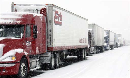 Vehicles are stranded on the New York State Thruway during a winter storm in Buffalo, N.Y., Thursday, Dec. 2, 2010. (AP Photo/David Duprey)