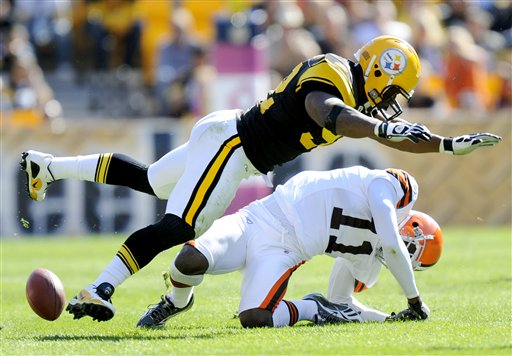 FILE - In this Oct. 17, 2010, file photo, Pittsburgh Steelers linebacker James Harrison (92) hits Cleveland Browns wide receiver Mohamed Massaquoi (11) during the second quarter of a an NFL football game in Pittsburgh. Harrison was fined $75,000, for his hit against Massaquoi. The NFL's brain, neck and spine committee meets Wednesday, Dec. 8, 2010, to talk about possible changes to helmets and other equipment. (AP Photo/Don Wright, File)