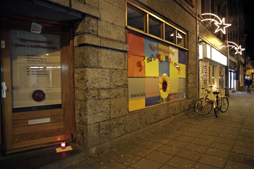 A lone candle with a note stands in the doorway of a daycare center in Amsterdam, Sunday Dec. 12, 2010, where a man suspected of abusing preschool children was employed. Parents of dozens of preschool children in Amsterdam have been warned their children may have been abused by a baby sitter in one of the worst sexual abuse cases to come to light in the Netherlands. Authorities say a 27-year-old suspect was arrested after a tip from U.S. authorities about child pornography. The man's computers have been seized and he has confessed to dozens of sex crimes at two Amsterdam daycare centers over the past 18 months, police chief Herman Bolhaar said at a press conference Sunday. (AP Photo/Peter Dejong)