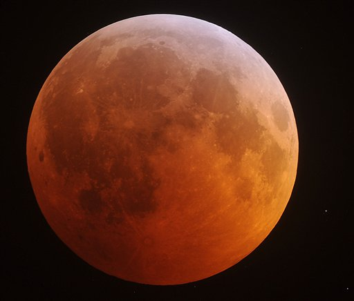 moon phases 2011 north america. The eclipsed moon glows in the