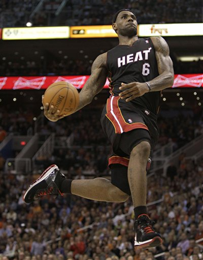 lebron james heat dunking. Miami Heat forward LeBron