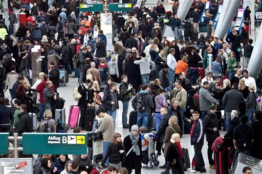 Passengers wait for their flights in a terminal of Duesseldorf airport, western Germany, Friday Dec. 24, 2010. According to German Dapd news agency the airport was shut down Friday for several hours due to bad weather conditions. (AP Photo/Dapd/dJakob Studnar)